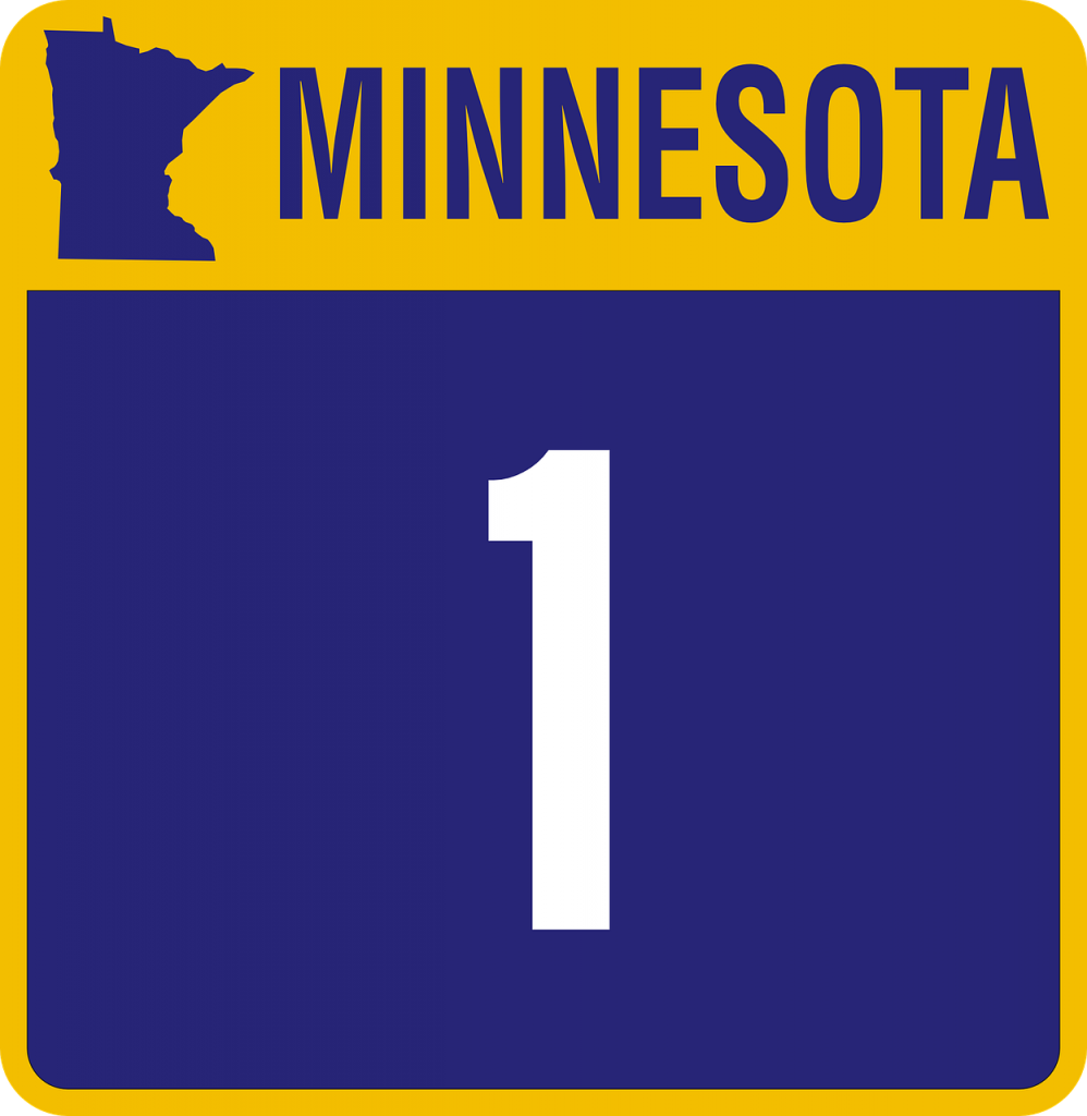 "Highway sign in purple and gold with a map of Minnesota and the number one. The word ""Minnesota"" is written at the top."